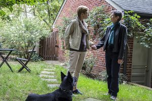 Mary Klein and Stella Dawson with their dog in their Washington DC garden (photo by Francis Ying_KHN)