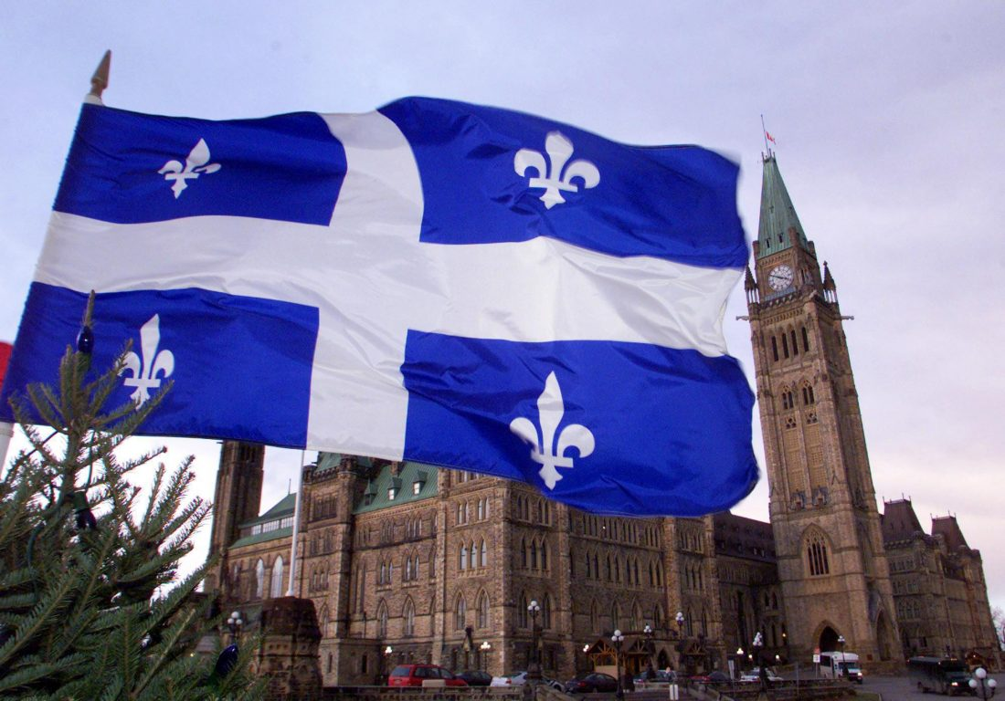 The Quebec fleur-de-lis flag flutters over the Parliament buildings in Ottawa Thursday Dec 16, 1999 as the House of Commons prepares to adjourn for the last time in the 1900s. When  parliament reconvenes in 2000, the debate over the Quebec constitutional problem will most likely be front and centre. (CP PHOTO/Tom Hanson)
